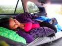 The maternity sleep system, set up in the back of a Subaru Outback.